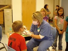 Dawn Kubinski- Dental Assistant from Crocker applying Varnish